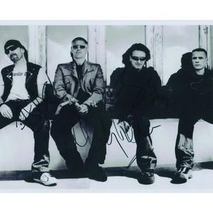 U2 (Bono, The Edge, Adam Clayton)